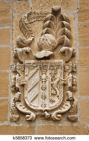 Stock Photo of Carved stone coat of arms on the wall k5858373.
