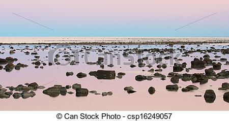 Stock Images of Hudson Bay Low Tide Stone Desert at dusk.