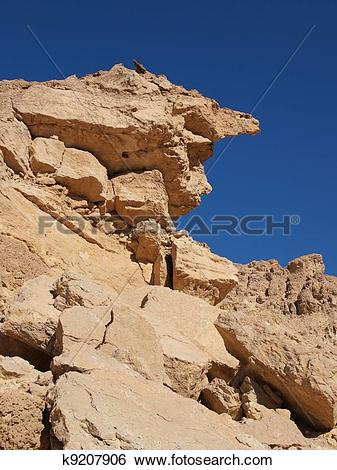 Stock Images of Scenic weathered yellow rock in stone desert.