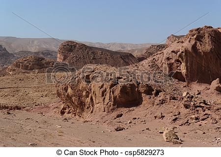Stock Photos of Scenic weathered red rocks in stone desert.