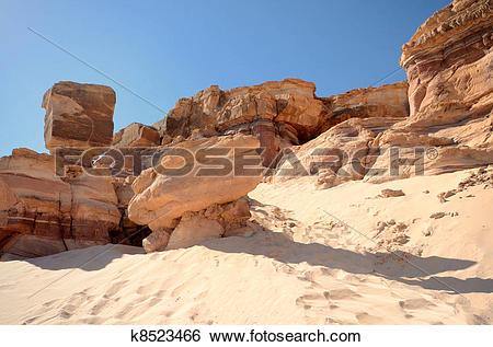 Stock Images of weathered orange rock in stone desert k8523466.
