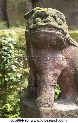 """Stock Image of """"Carved stone dog at a monastery, Leshan, Sichuan."""