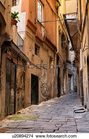 Stock Photo of Genoa Centro Storico: narrow cobbled alleyway with.