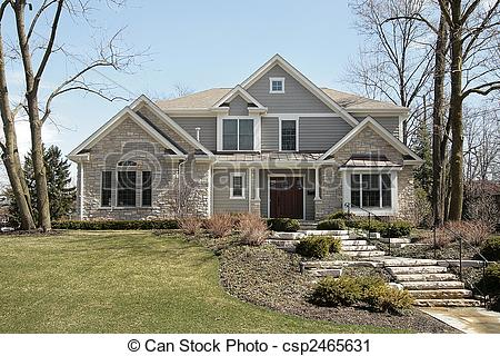 Stock Photography of Luxury home with stone facade.