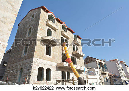 Stock Photo of Jerusalem stone facade on Restored building in.