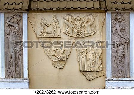 Stock Photo of stone facade fresco decoration scenes from ancient.