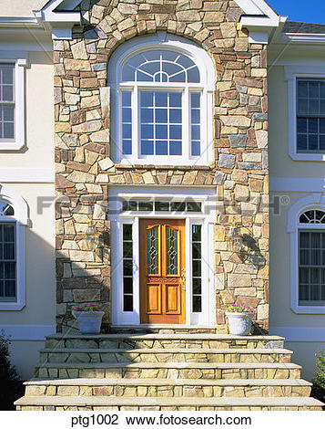 Stock Photo of Front entrance of elegant house with stone facade.