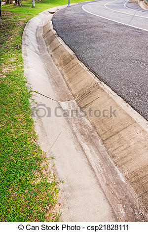 Stock Photography of Drain gutter cement beside the road.