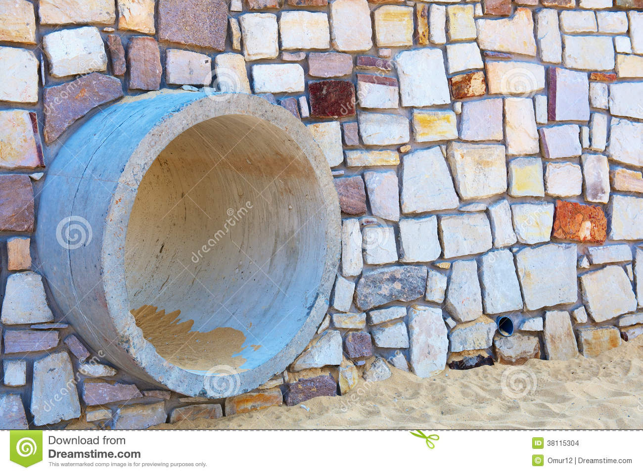 Gutter In A Stone Wall On The Beach Stock Images.