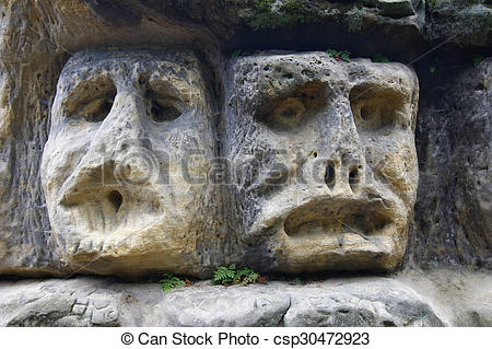 Stock Photo of Scary Stone Heads.