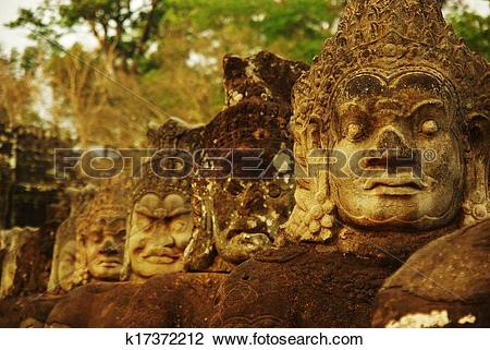 Stock Photo of Carved stone heads at ancient temple in Angkor Wat.