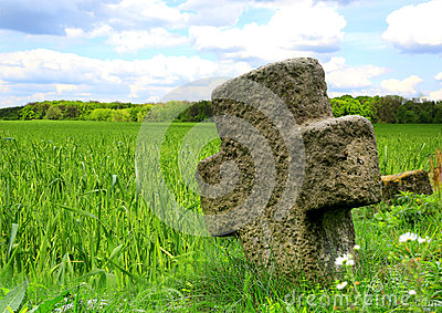 Old Stone Cross On Meadow Royalty Free Stock Photography.