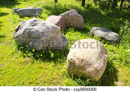 Stock Image of Large stones garden verdant meadow rural scenery.