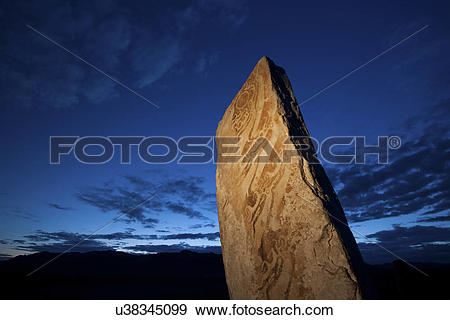 Stock Photograph of Deer stone marker, a standing stone with marks.