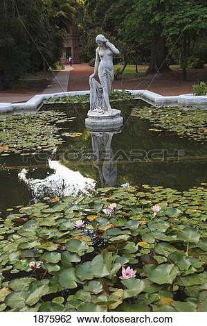 Stock Photo of Buenos Aires, Argentina; A Stone Statue In A Pond.