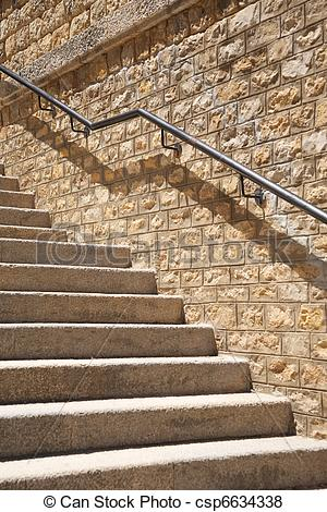 Pictures of stone steps with metal banister.