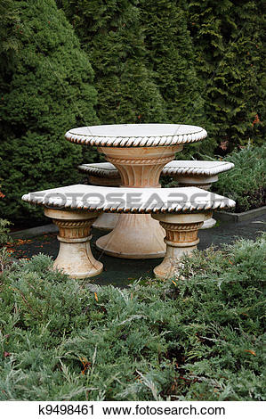 Stock Photography of a stone table and benches in the garden.