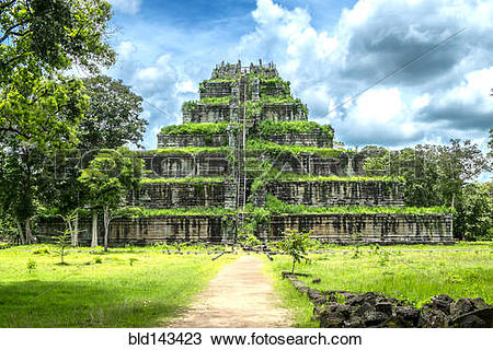 Stock Photo of Overgrown stone temple in remote field, Srayong.
