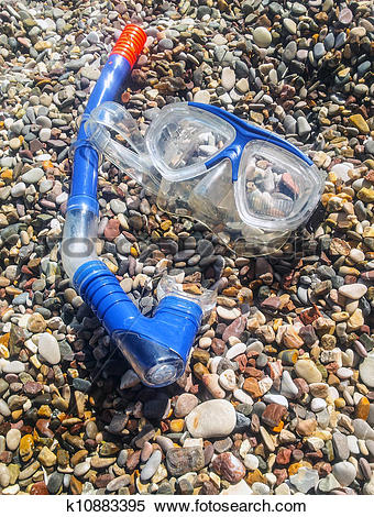 Stock Image of Diving mask and tube on pebble stone k10883395.