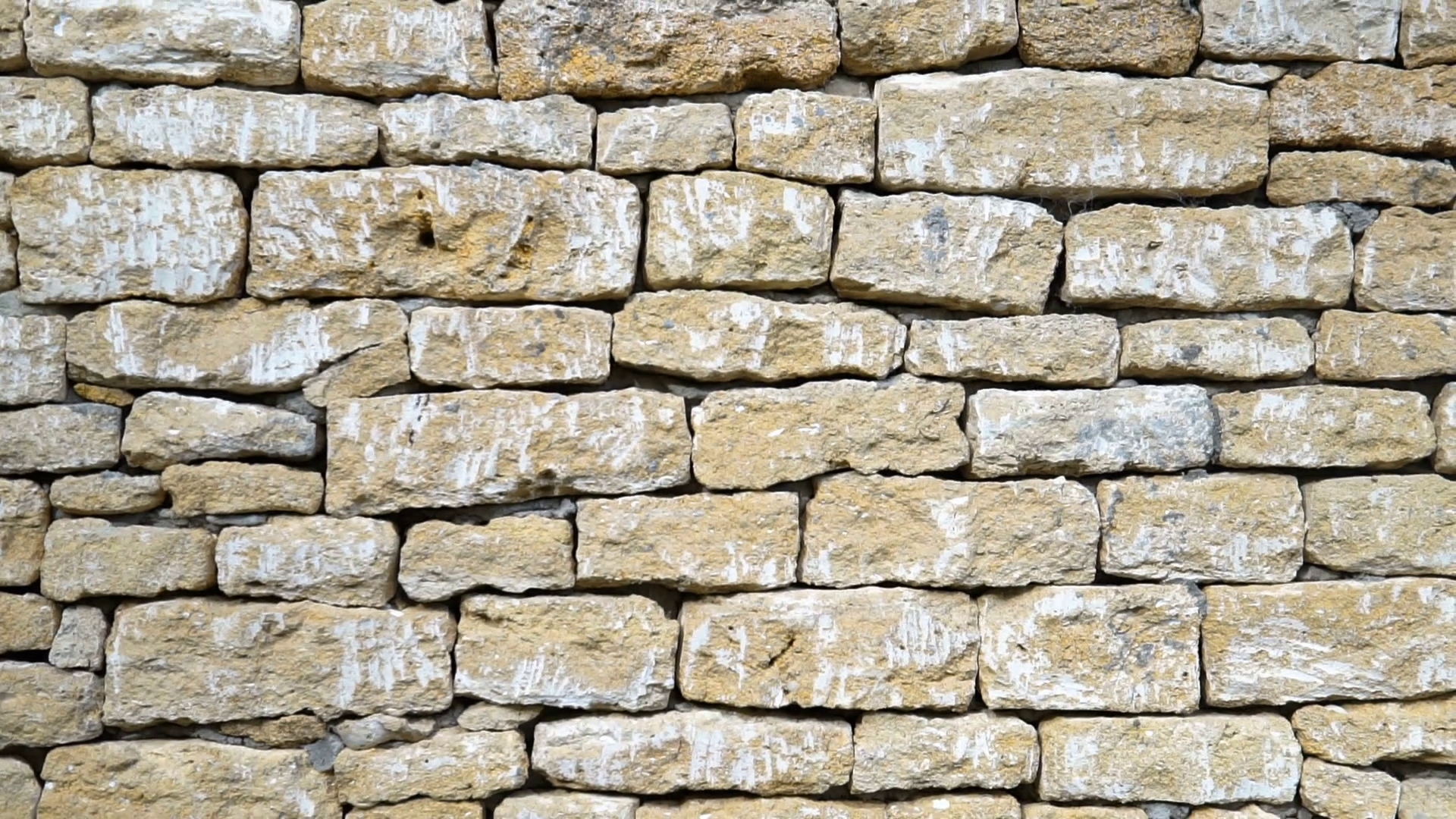 Texture of a stone wall. Old castle stone wall texture background. Stone  wall as a background or texture. Camera moving. Stock Video Footage.