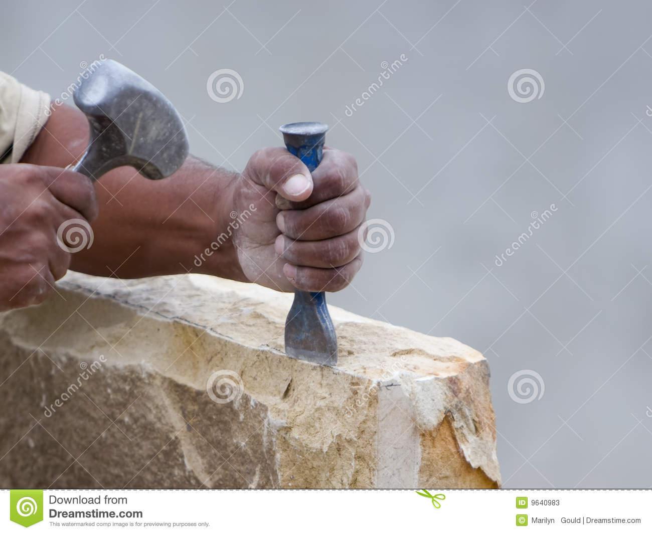 Stone Mason Chiseling A Block Of Stone Stock Photos.