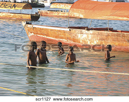 Picture of Africa. Zanzibar. Stone Town. Young boys playing.