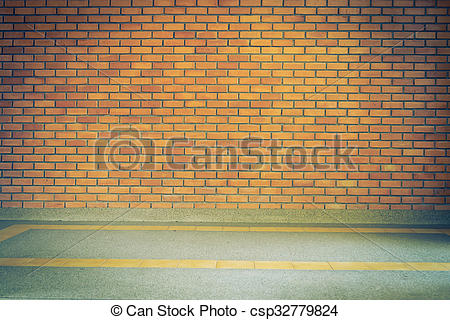 Stock Photo of brick wall texture background and small gravel.