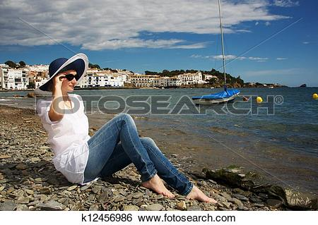 Stock Images of Woman on stony beach. k12456986.