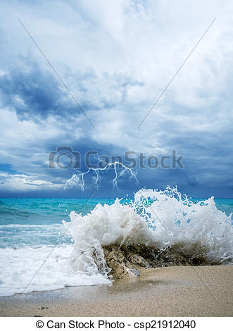 Stock Photo of waves breaking on a stony beach during a.