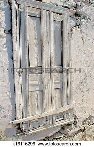 Stock Images of Wooden door painted white in stony wall covered.