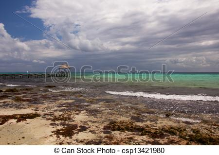 Pictures of Clouds Gather over Caribbean Beach.