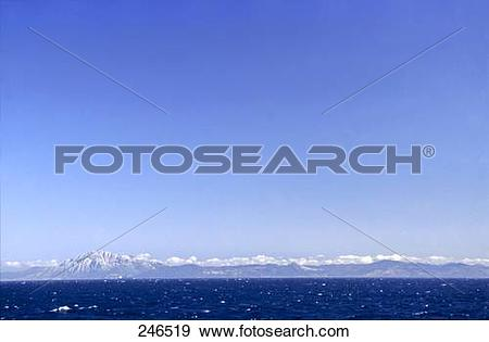 Stock Photograph of Panoramic view of mountain range across the.