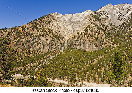 Stock Photos of Weathered mountain peaks and stream.