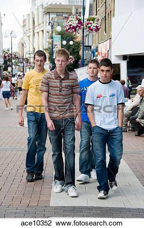 Stock Photo of 4 Teenage boys walking along the high street.