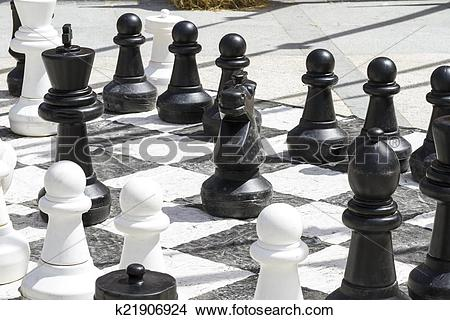 Stock Photo of Giant chess games in the street with large pieces.