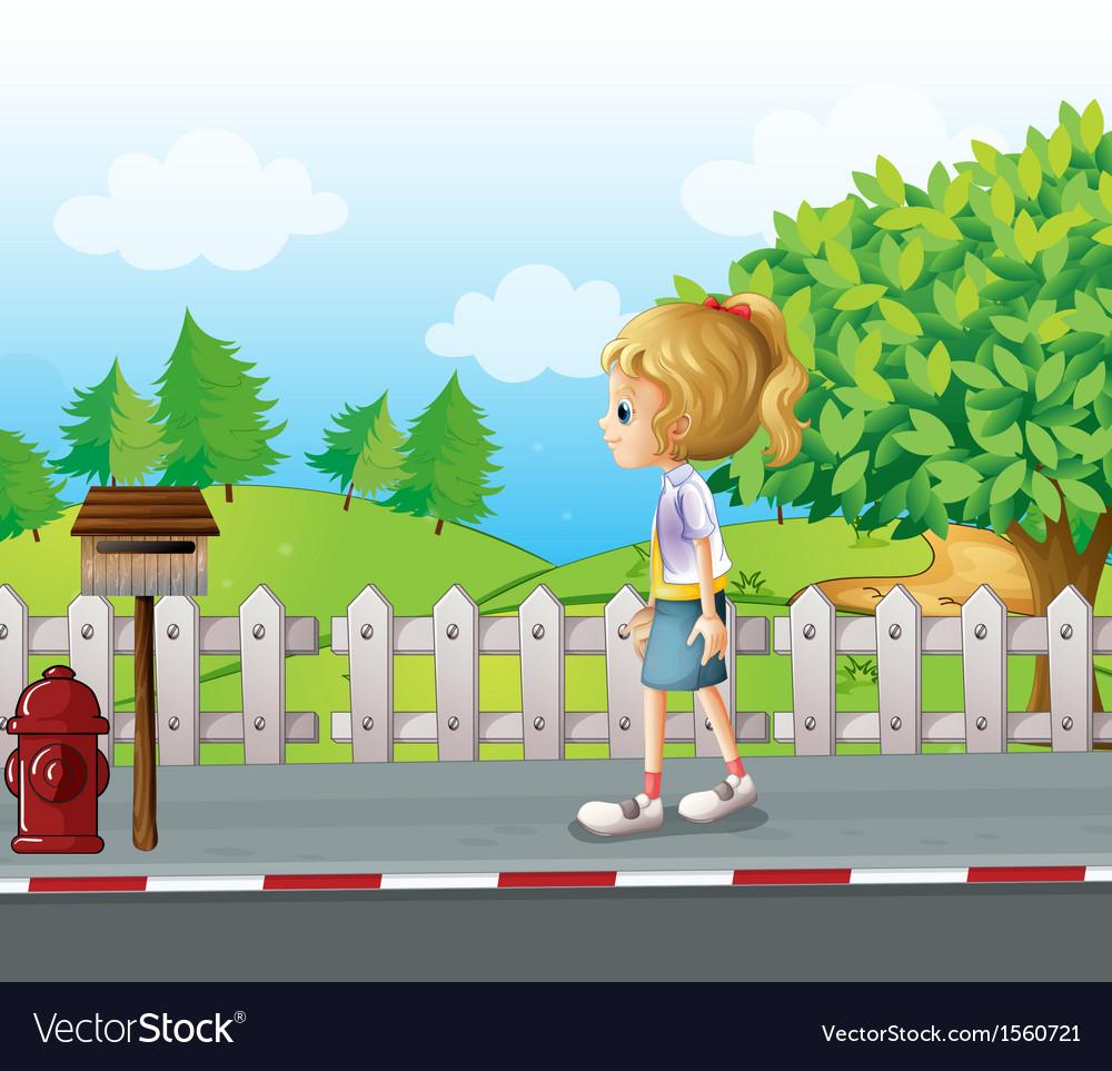 A lady walking in the street alone.