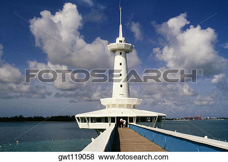 Pictures of Front view of a striking lighthouse against the sky.