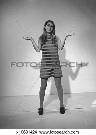 Stock Photo of Woman in striped dress gesturing in studio, (B&W.