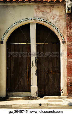 Stock Image of Facade of wooden doors on a stucco building, Los.