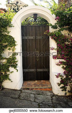 Stock Photography of Facade of wooden doors in a stucco arch, Los.