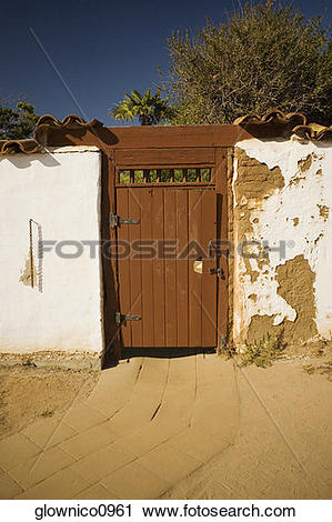 Stock Photography of Facade of a wooden door in a stucco wall.