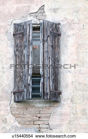 Stock Photo of Detail of old stucco house with crumbling pale pink.