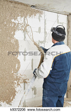 Stock Images of Plasterer at stucco work with liquid plaster.