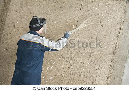 Stock Photography of Plasterer at stucco work with liquid plaster.