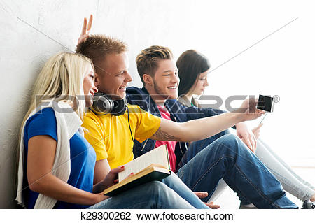 Stock Photo of Group of happy students being on a break taking.