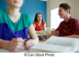 Stock Photo of group of happy students talking at school break.