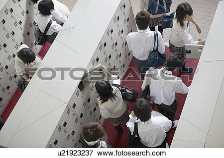 Picture of High school student at locker changing shoes, Japan.
