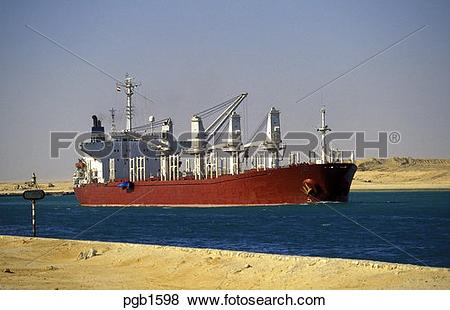 Pictures of Suez Canal, Egypt. Bulk carrier sailing through the.