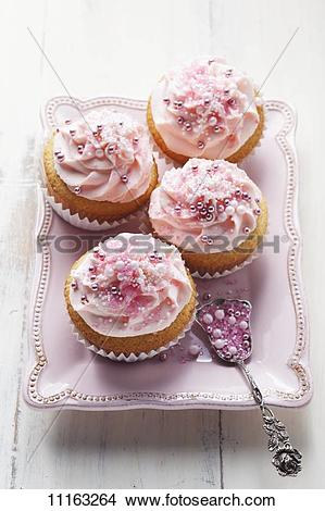 Stock Photo of Pink cupcakes with sugar pearls 11163264.