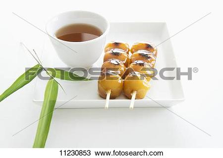 Stock Photo of Mochi (rice balls, Japan) in a syrup made from soy.